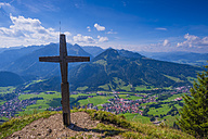 Germany, Bavaria, Summit cross on the Hirschberg with view to Bad Hindeland in th Ostrach Valley - WGF00991