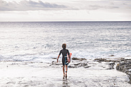 Tenerife, young surfer at the beach - SIPF00922