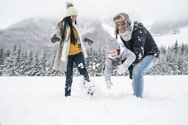 Happy family in winter landscape - HAPF00965