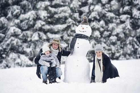 Family posing at snowman - HAPF00980
