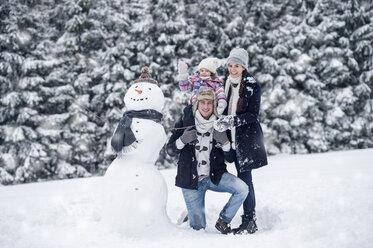 Family posing at snowman - HAPF00986