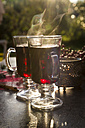 Two glasses of steaming mulled wine - SARF02983
