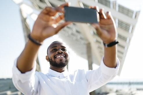 Man taking selfie outdoors - JRFF00937