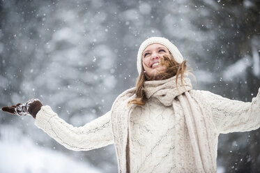 Young woman having fun in snow - HHF05419