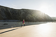 France, Crozon peninsula, teenage girl running on the beach - UUF08622