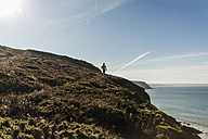 France, Crozon peninsula, young man running at the coast - UUF08640