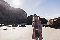 France, Crozon peninsula, teenage girl on cell phone on the beach - UUF08646