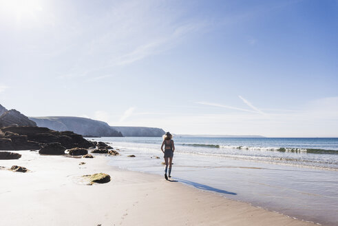 France, Crozon peninsula, teenage girl walking on the beach - UUF08661