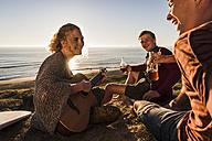 Three friends having fun at seaside - UUF08794