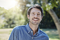 Portrait of smiling man in park - RORF00316