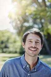 Portrait of smiling man in park - RORF00319