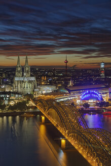 Germany, Cologne, view to the lighted city at evening twilight - GFF00840