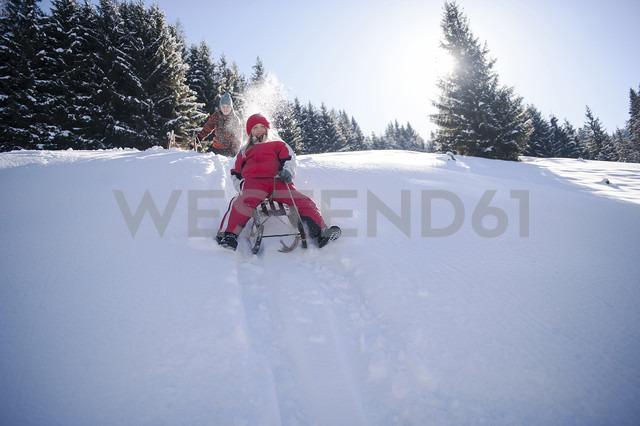 Children tobogganing in the snow - HHF05442