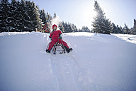 Children tobogganing in the snow - HHF05442