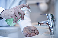 Doctor washing hands with soap - ZEF10609