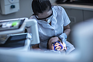 Boy in dental surgery receiving orthodontic treatment - ZEF10645