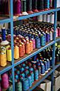 Multicolored cotton reels on shelf - ZEF10696