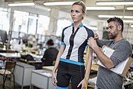 Tailor measuring arm of model wearing sportswear - ZEF10699