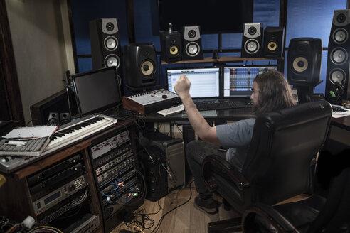 Audio engineer working in recording studio - ZEF10743
