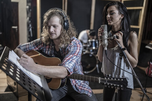 Singer and guitarist in recording studio - ZEF10755