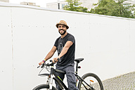 Portrait of smiling man on bicycle - TAMF00699