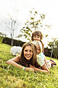 Three girls having fun together on a meadow - MGOF02536