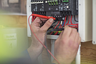 Electrician working on electrical panel - ZEF10900