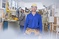 Electrician training, student with hardhat and toolbelt - ZEF10903