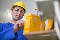 Electrician working with voltmeter - ZEF10906