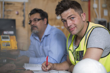 Confident young man attending an electrician workshop - ZEF10918