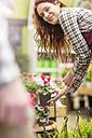 Woman working at garden centre - ZEF10984