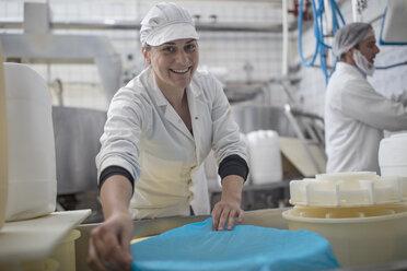 Cheese factory worker at work, portrait - ZEF11050