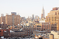 USA, New York City, Meatpacking District with Empire State Building in the background - BMAF00247