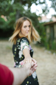 Woman holding man's hand - JCF00065