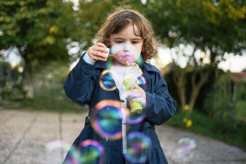 Little girl blowing soap bubbles - LOMF00431