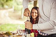 Man opening bottle of wine - ZEDF00375