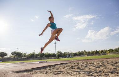 Female long jumper mid-air - ABZF01372