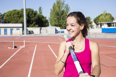Smiling female pole vaulter - ABZF01387