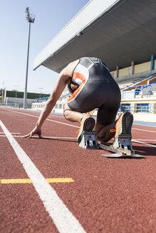 Runner on tartan track in starting position - ABZF01396