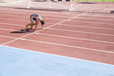 Runner on tartan track in starting position - ABZF01399