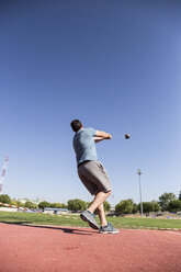 Athlete performing a hammer throw - ABZF01408