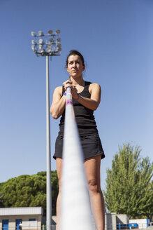 Female pole vaulter preparing - ABZF01411