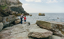 Grandfather and grandson fishing together at the sea - DAPF00418