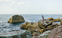 Senior man fishing at the sea - DAPF00436