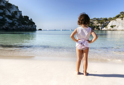 Back view of little girl standing at seafront - MGOF02557