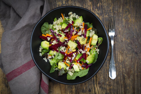 Bowl of autumnal salad with lettuce, carrots, avocado, beetroot, pumpkin and sunflower seeds, pomegranate and quinoa - LVF05489