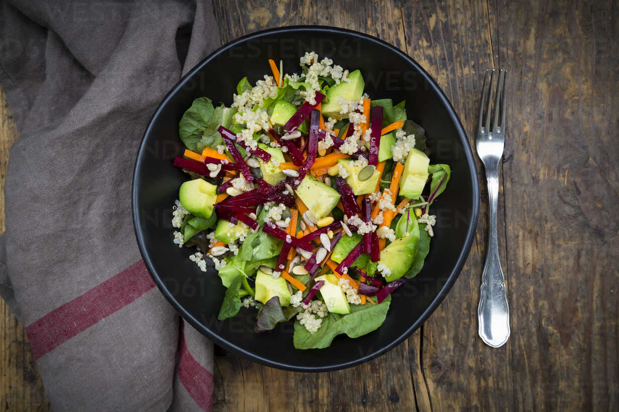 Bowl of autumnal salad with lettuce, carrots, avocado, beetroot, pumpkin and sunflower seeds, pomegranate and quinoa - LVF05489 - Larissa Veronesi/Westend61