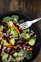Bowl of autumnal salad with lettuce, carrots, avocado, beetroot, pumpkin and sunflower seeds, pomegranate and quinoa - LVF05492