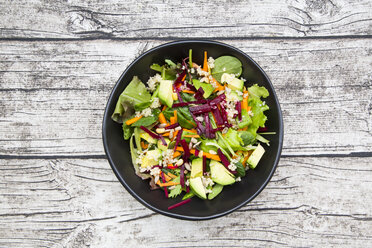 Bowl of autumnal salad with lettuce, carrots, avocado, beetroot, pumpkin and sunflower seeds, pomegranate and quinoa - LVF05495