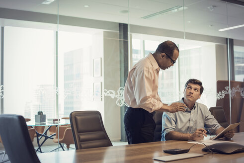 Two businessmen working together in office - WESTF21838